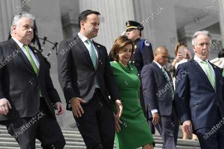 Stock Photo of House Speaker Nancy Pelosi of Calif., in green, walks down the steps with Rep. Peter King, D-N.Y., Irish Prime Minister Leo Varadkar, and Rep. Richard Neal, D-Mass., following a lunch on Capitol Hill in Washington