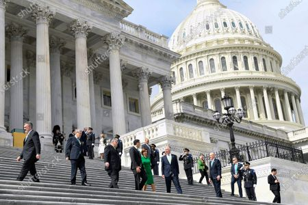 House Speaker Nancy Pelosi of Calif., in green, walks down the steps with Rep. Peter King, D-N.Y., Irish Prime Minister Leo Varadkar, and Rep. Richard Neal, D-Mass., following a lunch on Capitol Hill in Washington