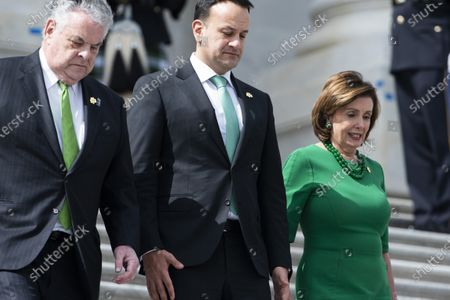 Stock Image of Ireland's Taoiseach (Prime Minister) Leo Varadkar (C), Democratic Speaker of the House from California Nancy Pelosi (R), and Republican Representative from New York Peter King (L) leave the US Capitol after a luncheon in Washington, DC, USA, 12 March, 2020. On 11 March, President Trump announced a travel ban between the United States and Europe for non citizens.