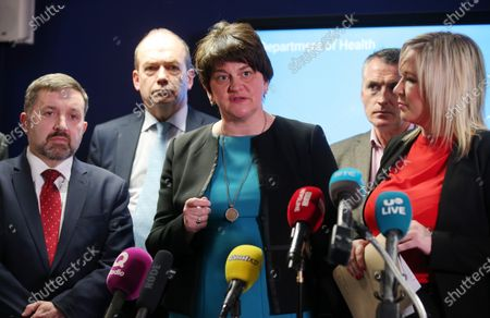 Stock Image of Health Minister Robin Swan, First minister Arlene Foster, Deputy Forst Minister Michelle O'Neill with Chief Medical Officer Dr Michael McBride(back left) and Jnr Minister Declan Kearney (back right) speak at a press conference following the meeting.