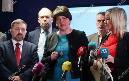Health Minister Robin Swan, First minister Arlene Foster, Deputy Forst Minister Michelle O'Neill with Chief Medical Officer Dr Michael McBride(back left) and Jnr Minister Declan Kearney (back right) speak at a press conference following the meeting.