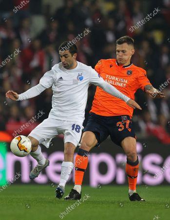 Basaksehir's Martin Skrtel, right, fights for the ball with Copenhagen's Michael Santos, left, during a Europa League top 16 first leg soccer match between Basaksehir and Copenhagen, in Istanbul