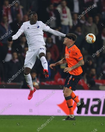 Basaksehir's Martin Skrtel right, fights for the ball with Copenhagen's Mohamed Daramy, left, during a Europa League top 16 first leg soccer match between Basaksehir and Copenhagen, in Istanbul