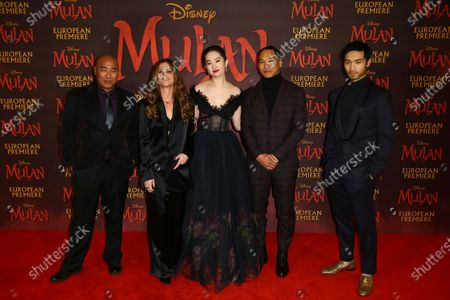 Actors, from left to right, Ron Yuan, Director Niki Caro, Yifei Liu, Jason Scott Lee and Yoson An, pose for photographers upon arrival at the European Premiere of 'Mulan' at a central London cinema