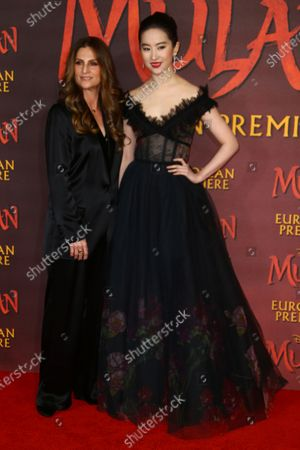 Actress Yifei Liu, right and Director Niki Caro pose for photographers upon arrival at the European Premiere of 'Mulan' at a central London cinema