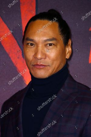 Actor Jason Scott Lee poses for photographers upon arrival at the European Premiere of 'Mulan' at a central London cinema