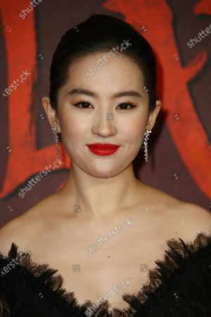Actress Yifei Liu poses for photographers upon arrival at the European Premiere of 'Mulan' at a central London cinema
