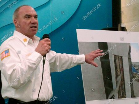 Atlantic City, N.J., Fire Chief Scott Evans speaks at a news conference, in Atlantic City, calling for the immediate demolition of the former Trump Plaza casino, parts of which have crumbled and fallen onto a sidewalk