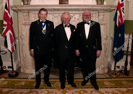 Prince Charles poses with the Lord Mayor of the City of London, William Russell (L) and the High Commissioner for Australia, George Brandis (R) as they attend a dinner in aid of the Australian bushfire relief and recovery effort at Mansion House