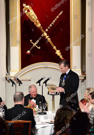 Stock Picture of Prince Charles (L) listens to a speech by the Lord Mayor of the City of London, William Russell as they attend a dinner in aid of the Australian bushfire relief and recovery effort at Mansion House