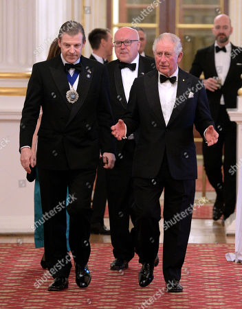 Prince Charles (R) and the Lord Mayor of the City of London, William Russell as they attend a dinner in aid of the Australian bushfire relief and recovery effort at Mansion House