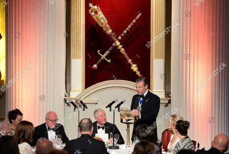 Prince Charles (L) listens to a speech by the Lord Mayor of the City of London, William Russell as they attend a dinner in aid of the Australian bushfire relief and recovery effort at Mansion House