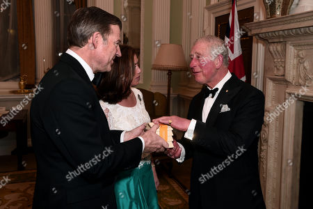 Prince Charles (R) shares a joke with Hilary Russell and the Lord Mayor of the City of London, William Russell as they attend a dinner in aid of the Australian bushfire relief and recovery effort at Mansion House