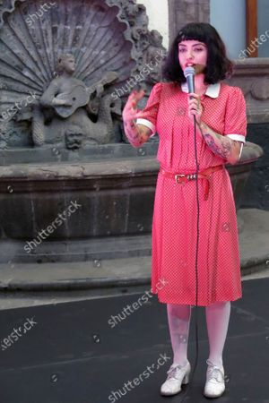 """The Chilean singer Mon Laferte speaks during a press conference promoting her first art exhibition, """"Gestos"""" or Gestures, in a patio at the Museum of Mexico City, . Mon Laferte's nearly 70 works of art showing various techniques including ink, oils and mixed media will be on exhibit from March 12 through April 12"""