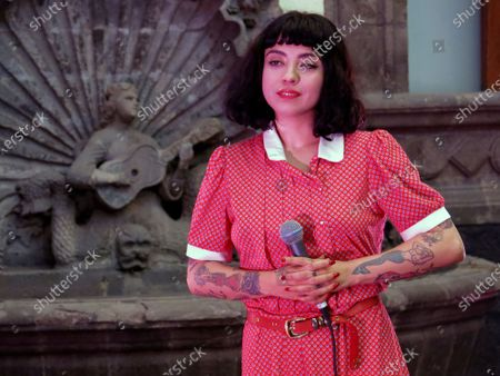 """The Chilean singer Mon Laferte takes part in a press conference promoting her first art exhibition, """"Gestos"""" or Gestures, in a patio at the Museum of Mexico City, . Mon Laferte's nearly 70 works of art showing various techniques including ink, oils and mixed media will be on exhibit from March 12 through April 12"""