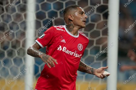 Paolo Guerrero of Brazil's Internacional reacts after missing an opportunity to score during a Copa Libertadores soccer match against Brazil's Gremio at Gremio Arena in Porto Alegre, Brazil