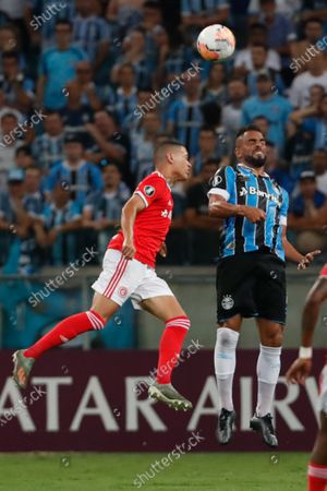 Maicon (R) of Gremio in action against Marcos Guilherme (L) of Internacional during the Copa Libertadores group E soccer match between Gremio and Internacional at the Arena do Gremio, in Porto Alegre, Brazil, 12 March 2020.