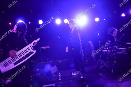 Actor and singer Michael C. Hall, center, multi-instrumentalist Matt Katz-Bohen, left, and drummer Peter Yanowitz of Princess Goes To The Butterfly Museum perform at the Mercury Lounge, in New York