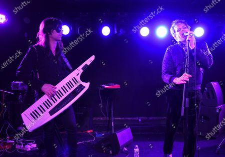 Actor and singer Michael C. Hall, right, and multi-instrumentalist Matt Katz-Bohen of Princess Goes To The Butterfly Museum perform at the Mercury Lounge, in New York
