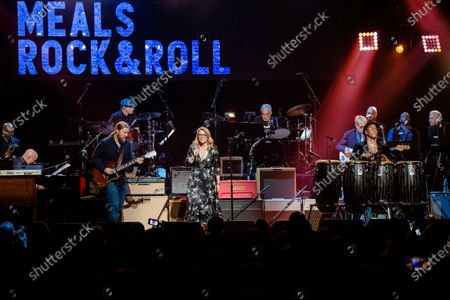 Derek Trucks, from left, Susan Tedeschi, and Pedrito Martinez perform at Love Rocks NYC!, a Benefit Concert for God's Love We Deliver at the Beacon Theatre on in New York