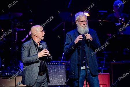 Paul Shaffer, left, and David Letterman speak at Love Rocks NYC!, a Benefit Concert for God's Love We Deliver at the Beacon Theatre on in New York