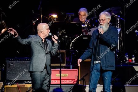 Stock Picture of Paul Shaffer, left, and David Letterman speak at Love Rocks NYC!, a Benefit Concert for God's Love We Deliver at the Beacon Theatre on in New York