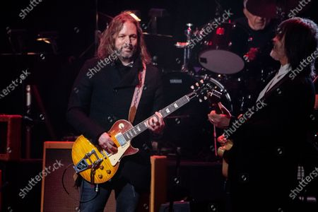 Rich Robinson, left, performs at Love Rocks NYC!, a Benefit Concert for God's Love We Deliver at the Beacon Theatre on in New York