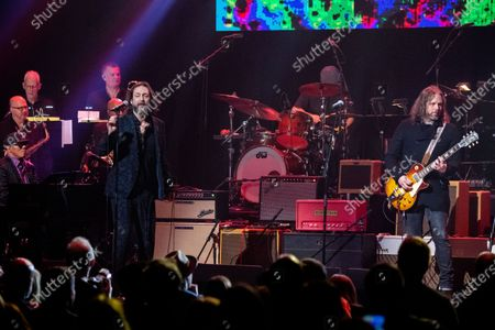 Ivan Neville, from left, Chris Robinson, and Rich Robinson perform at Love Rocks NYC!, a Benefit Concert for God's Love We Deliver at the Beacon Theatre on in New York