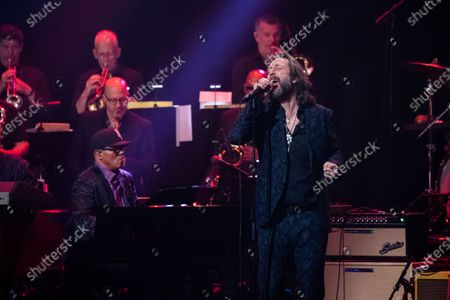 Ivan Neville, left, and Chris Robinson perform at Love Rocks NYC!, a Benefit Concert for God's Love We Deliver at the Beacon Theatre on in New York