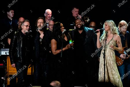 Stock Picture of Jackson Brown, from left, Chris Robinson, Tanya Blount-Trotter, Michael Trotter Jr., Joss Stone, and Derek Trucks perform at Love Rocks NYC!, a Benefit Concert for God's Love We Deliver at the Beacon Theatre on in New York