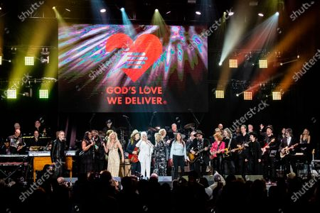 Ivan Neville, from left, Jackson Browne, Michael Trotter Jr., Tanya Blount-Trotter, Joss Stone, Marcus King, Cyndi Lauper, Susan Tedeschi, Steve Allen, Karen Pearl, Jimmie Vaughan, Jimmy Vivino, Sue Foley, Rich Robinson, and Emily King perform at Love Rocks NYC!, a Benefit Concert for God's Love We Deliver at the Beacon Theatre on in New York
