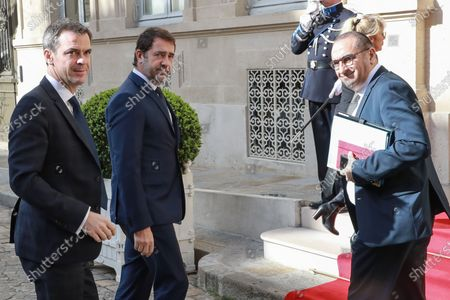 French Health and Solidarity Minister Olivier Veran (L) is welcomed by French Interior Minister Christophe Castaner (C) and French Junior Interior Minister Laurent Nunez (R) as he attends a video meeting with French regions prefects on the COVID-19 coronavirus epidemic in Paris, France, 13 March 2020. The meeting is on the day after French President Macron said it was 'the worst health crisis in France in a century' as he ordered schools and universities closed 'until further notice'.