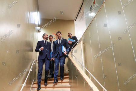 (L-R) French Prime Minister Edouard Philippe, French Health and Solidarity Minister Olivier Veran, French Interior Minister Christophe Castaner, and French Junior Interior Minister Laurent Nunez walk towards the 'crisis room' of the French Interior ministry in Paris, France, 13 March 2020, for a video meeting with French regions prefects on the COVID-19 epidemic, the day after French President said it was 'the worst health crisis in France in a century' as he ordered schools and universities closed 'until further notice'.