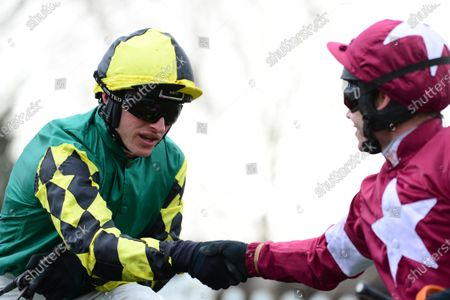 Cheltenham. Paddy Power Stayers´Hurdle (Grade 1) LISNAGAR OSCAR jockey Adam Wedge is congratulated by Richard Johnson (r) after win for trainer Rebecca Curtis.