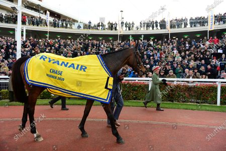 Stock Image of Cheltenham. Ryanair Chase (Grade 1). MIN and Paul Townend win foir trainer Willie Mullins and owner Rich Ricci from SAINT CALVADOS and A PLUS TARD.