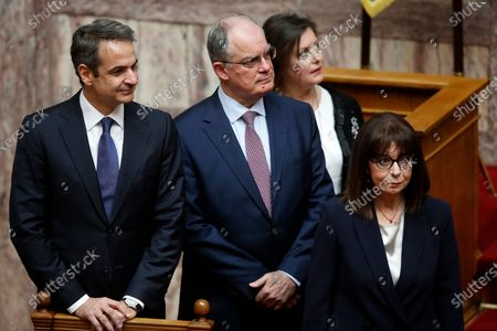 Newly elected Greek President Katerina Sakellaropoulo (R), accompanied by Greece's Prime Minister Kyriakos Mitsotakis (L) and the Spokesman of the Greek Parliament Konstantinos Tasoulas (C) arrives for the swearing-in ceremony at the Greek Parliament in Athens, Greece, 13 March 2020. Greece's first female president, a former high court judge, was being formally sworn in to office on 13 March, nearly two months after the country's parliament voted overwhelmingly to elect her. The swearing in ceremony for Katerina Sakellaropoulou was held in an almost empty parliament, as part of measures being taken to prevent the spread of the new coronavirus.