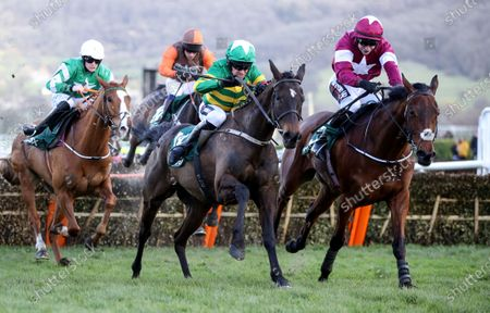 Randox Health County Handicap Hurdle. Barry Geraghty and Saint Roi lead James Slevin over the last to win
