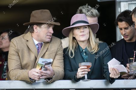 Peter Phillips and Autumn Phillips watch the first race