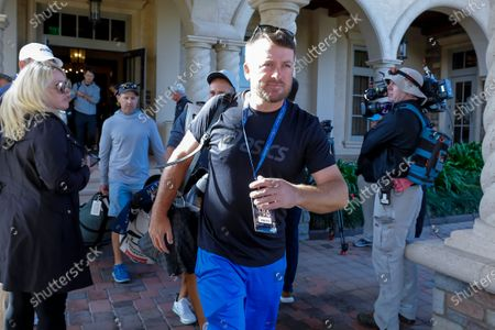 Graeme McDowell of Northern Ireland leaves the TPC Sawgrass Clubhouse after it was announced the remainder of THE PLAYERS Championship golf tournament has been cancelled due to the coronavirus COVID-19 pandemic in Ponte Vedra Beach, Florida, USA, 13 March 2020. The PGA Tour said all of its events through the Valero Texas Open in late March 2020 have been cancelled.