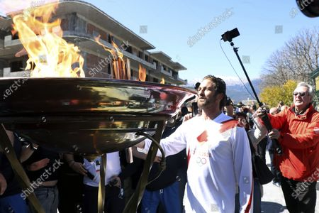 "Stock Picture of Actor Gerard Butler lights an altar as a torchbearer during the Olympic torch relay of the 2020 Tokyo Olympic Games in the southern Greek town of Sparta, . Greece's Olympic committee says it is suspending the rest of its torch relay for the Olympic flame due to the ""unexpectedly large crowd"" that gathered to watch despite repeated requests for the public to stay away to prevent the spread of the new coronavirus"