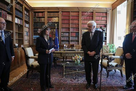 Stock Image of Newly sworn-in Greek President Katerina Sakellaropoulou speaks during a handover ceremony from outgoing President Prokopis Pavlopoulos (2-R) at the Presidential Palace, in Athens, Greece, 13 March 2020. Greece's first female president, a former high court judge, was being formally sworn in to office on 13 March, nearly two months after the country's parliament voted overwhelmingly to elect her. The swearing in ceremony for Katerina Sakellaropoulou was held in an almost empty parliament, as part of measures being taken to prevent the spread of the new coronavirus.