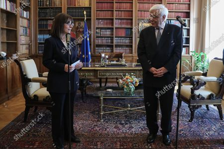 Newly sworn-in Greek President Katerina Sakellaropoulou speaks during a handover ceremony from outgoing President Prokopis Pavlopoulos at the Presidential Palace, in Athens, Greece, 13 March 2020. Greece's first female president, a former high court judge, was being formally sworn in to office on 13 March, nearly two months after the country's parliament voted overwhelmingly to elect her. The swearing in ceremony for Katerina Sakellaropoulou was held in an almost empty parliament, as part of measures being taken to prevent the spread of the new coronavirus.
