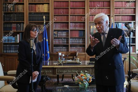 Stock Photo of Newly sworn-in Greek President Katerina Sakellaropoulou speaks during a handover ceremony from outgoing President Prokopis Pavlopoulos at the Presidential Palace, in Athens, Greece, 13 March 2020. Greece's first female president, a former high court judge, was being formally sworn in to office on 13 March, nearly two months after the country's parliament voted overwhelmingly to elect her. The swearing in ceremony for Katerina Sakellaropoulou was held in an almost empty parliament, as part of measures being taken to prevent the spread of the new coronavirus.