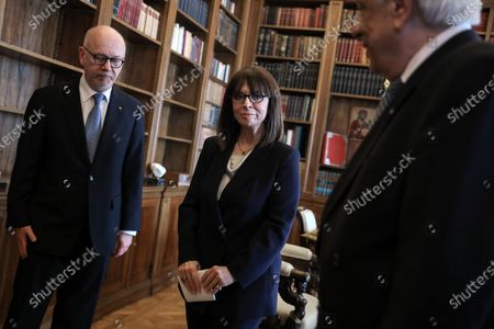 Newly sworn-in Greek President Katerina Sakellaropoulou attends the handover ceremony from outgoing President Prokopis Pavlopoulos (2-R) at the Presidential Palace, in Athens, Greece, 13 March 2020. Greece's first female president, a former high court judge, was being formally sworn in to office on 13 March, nearly two months after the country's parliament voted overwhelmingly to elect her. The swearing in ceremony for Katerina Sakellaropoulou was held in an almost empty parliament, as part of measures being taken to prevent the spread of the new coronavirus.