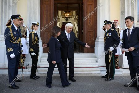 Stock Picture of Newly sworn-in Greek President Katerina Sakellaropoulou (L) is welcomed by outgoing Greek President Prokopis Pavlopoulos (R) during a handover ceremony at the Presidential Palace, in Athens, Greece, 13 March 2020. Greece's first female president, a former high court judge, was being formally sworn in to office on 13 March, nearly two months after the country's parliament voted overwhelmingly to elect her. The swearing in ceremony for Katerina Sakellaropoulou was held in an almost empty parliament, as part of measures being taken to prevent the spread of the new coronavirus.