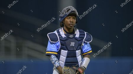 Stock Image of Southern University catcher Brandon Green reads a call from the dugout during an NCAA baseball game against the University of New Orleans, in New Orleans