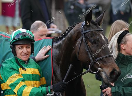 Cheltenham Racecourse Festival Day 4 The Random Health County Handicap Hurdle Race. Barry geraghty with Saint Roy in the winners enclosure.