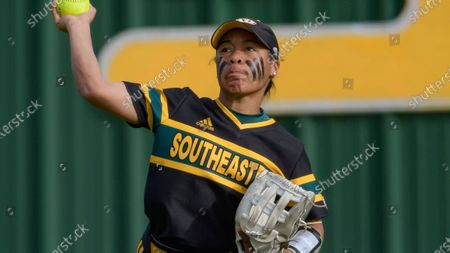 Stock Image of Southeastern Louisiana outfielder Cameron Goodman throws during an NCAA softball game against Appalachian State, in Hammond, La