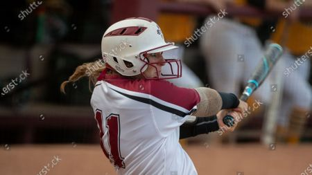 New Mexico State's Nikki Butler (11) swings at a pitch during an NCAA softball game against Wright State, in Tempe, Ariz