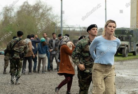 Yosef Kasnetzkov as Border Agent and Betty Gilpin as Crystal